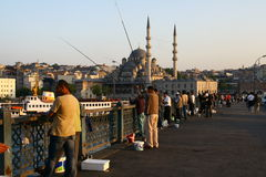 Men fishing in Galata Bridge Royalty Free Stock Images
