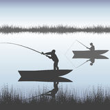 Men fishing on lake from boat. Men silhouettes fishing on lake from boat Royalty Free Stock Images
