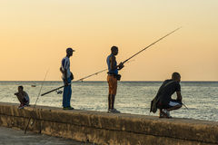 Men fishing at Malecon Havana. Men fishing at Malecon sunset in Havana, Cuba. Citizens of Havana is called Habaneros in Spanish Royalty Free Stock Photography
