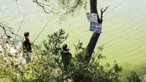 Men fishing in the marsh of Foix Royalty Free Stock Image
