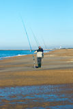 Men fishing in ocean on the beach of Biarritz Royalty Free Stock Image