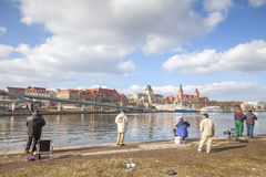 Men fishing in the Odra River. Stock Images