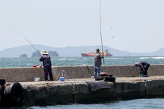 Men fishing off the pier Stock Photography