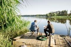 Free Men Fishing On The Lake Royalty Free Stock Photography - 121187597