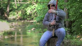 Men are fishing by the river in the morning stock video footage
