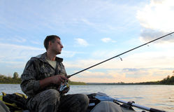 Men fishing with spinning Stock Photography