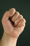 Men fist over black. Close up of men fist over black background Stock Photography