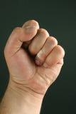 Men fist over black Stock Photography