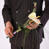 Men with flower. Men with bouquet of flowers royalty free stock photo