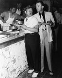 Men in food line. (All persons depicted are no longer living and no estate exists. Supplier grants that there will be no model release issues royalty free stock images