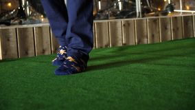 Men foot on green doormat. Men`s feet in socks on a green carpet.  Royalty Free Stock Images