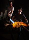 Men Forming Glass Art Stock Image