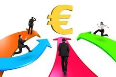 Men on four color arrows go toward golden Euro symbol. Isolated on white background Stock Photo
