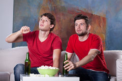 Men friends' home cinema Stock Photography