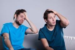 Men friends watching match Stock Photo