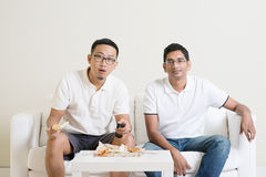 Men friends watching sport match on tv Stock Image
