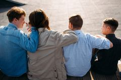 Men friendship teenager hug bff support unity. Men friendship. Back view of young teenagers hugging. Bff support unity teamwork concept Stock Photo