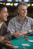 Men Gambling in Las Vegas. Men playing the card game blackjack in Las Vegas royalty free stock image