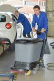 Men in the garage. Mechanic Royalty Free Stock Image