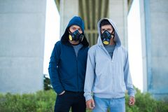 Men in gas masks Stock Images