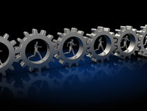 Men in gearwheels Royalty Free Stock Images