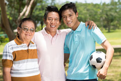 Men generation. Close-up portrait of a big men family smiling and looking at camera Stock Image