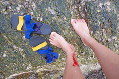 Men get accident slip when walking on the rock Royalty Free Stock Photo