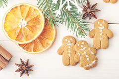 Men gingerbread and dried oranges with Christmas tree branches Royalty Free Stock Photos