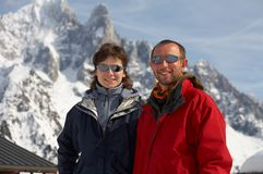 Men and girl in glasses. The men and girl in glasses on a background of snow mountains Stock Image