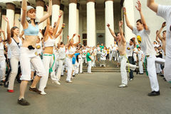 Men and girls dance on real capoeira performance Royalty Free Stock Image