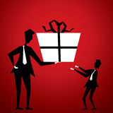 Men giving big gift Royalty Free Stock Photos
