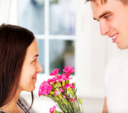 Men giving flowers to his lover woman. Valentine`s day. Anniversary. Men giving flowers to his lover woman Royalty Free Stock Images