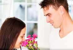 Men giving flowers to his lover woman. Valentine`s day. Anniversary. Men giving flowers to his lover woman Stock Photography