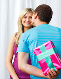 Men giving his girlfriend a present Stock Photography