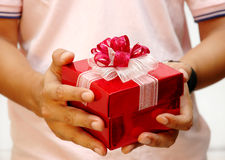 Men giving a present Stock Photos