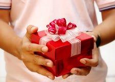 Men giving a present