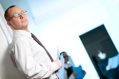 Men in glasses with folder Royalty Free Stock Photo