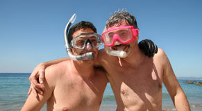 Men go snorkeling. Two men are about to go snorkeling in the ocean Royalty Free Stock Photography