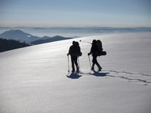 Men go in snowshoes in the mountains. Royalty Free Stock Photo