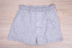 Men gray boxer shorts on wooden background Royalty Free Stock Photo