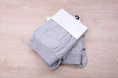 Men gray boxer shorts on wooden background Royalty Free Stock Images