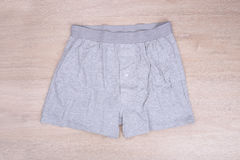 Men gray boxer shorts on wooden background Stock Images