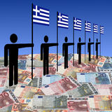 Men with Greek flags on euros Stock Photo