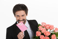 Men with greeting card and flowers. royalty free stock images