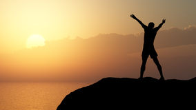 Men greeting sun. Stands on hill, ocean and yellow sunset Royalty Free Stock Image