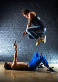 Men with guns fighting. Contrast colors Stock Photos