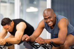 Men gym bike Stock Photos
