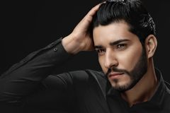 Men Hair Beauty. Handsome Male Model Touching Healthy Hair stock photography