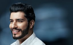 Men Hair Beauty. Handsome Man Model With Black Hair And Beard. On Blue Background. High Resolution stock photos