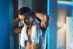 Men Hair Care. Man Touching His Hair In Bathroom. Men Grooming. Men Hair Care. Portrait Of Handsome Sexy Man With Naked Upper Body Touching His Thick Hair Royalty Free Stock Photo